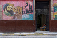 Mural and woman in Havana